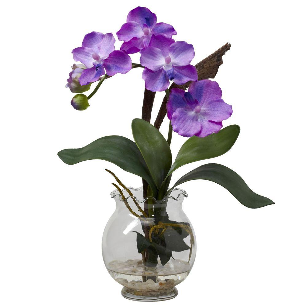 Nearly Natural 15 in. H Purple Mini Vanda with Fluted Vase Silk Flower Arrangement A delightful mixture of shapes, colors, and textures awaits you with this gorgeous Mini Vanda. Delicate green leaves curve upward, forming a base from which the soft blooms emerge. The result is a piece that looks like you paid a treasure hunter to find. A beautiful fluted bowl with faux water completes the picture. Makes a classy gift as well.