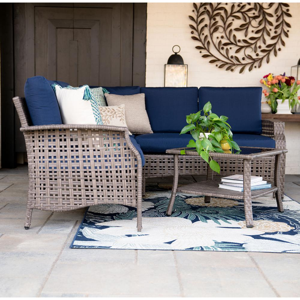 Leisure Made Concord 4-Piece Wicker Outdoor Sectional Set with Navy Cushions