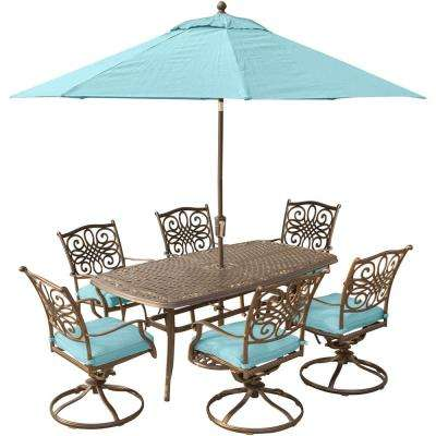 Traditions 7-Piece Outdoor Dining Set with Rectangular Cast Table and Swivels with Blue Cushions, Umbrella and Base