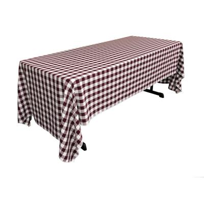 60 in. x 120 in. White and Burgundy Polyester Gingham Checkered Rectangular Tablecloth