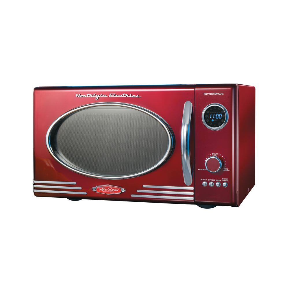 Nostalgia Retro Series 0.9 cu. ft. Countertop Microwave in Red With a beautiful and sleek retro design, this microwave is sure to stand out in any kitchen. It features 12-pre programmed cooking settings and a bright LED display, making usability simple. Five power levels and 800-Watt of power are perfect for reheating leftovers or cooking food. Color: Red.