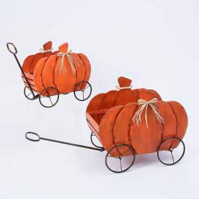 Assorted 21.85 in. Nesting Wood Pumpkin Wagons (Set of 2)