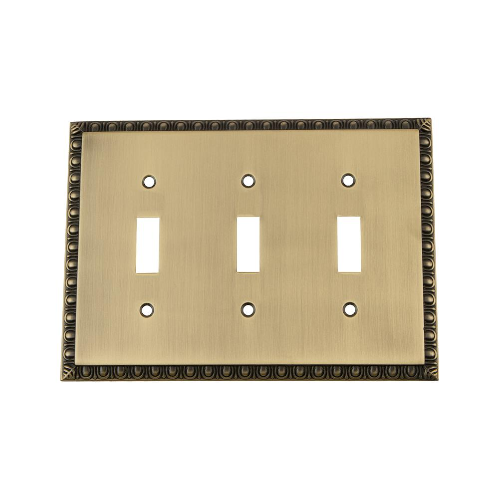 Nostalgic Warehouse Egg and Dart Switch Plate with Triple Toggle in Antique Brass
