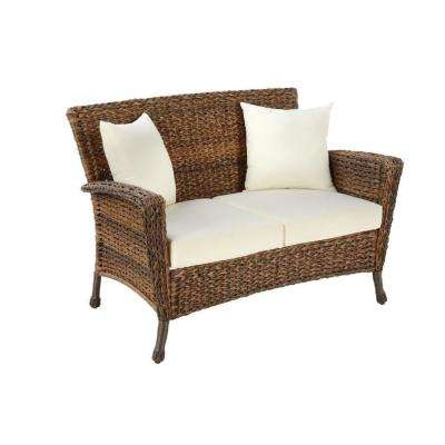 Rustic Wicker Outdoor Loveseat with Beige Cushions