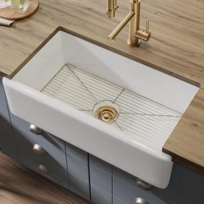 Turino Reversible Farmhouse Apron Front Fireclay 33 in. Single Bowl Kitchen Sink with Bottom Grid in Gloss White
