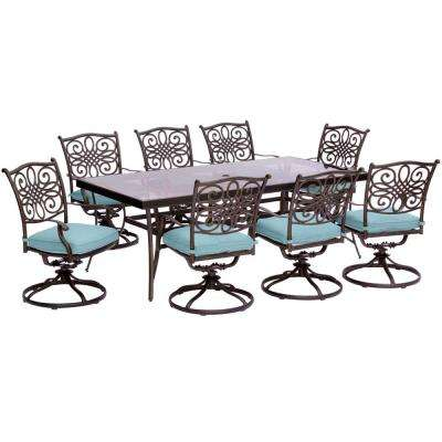 Traditions 9-Piece Aluminum Outdoor Dining Set with Rectangular Glass Table and Swivel Chairs with Blue Cushions