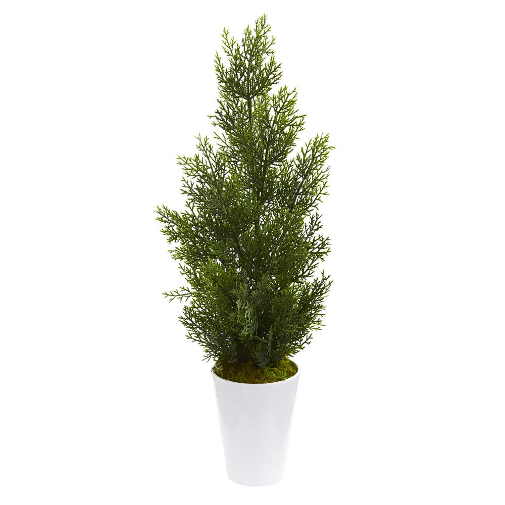 Nearly Natural Indoor/Outdoor 27 in. Mini Cedar Artificial Pine Tree in Decorative Planter Standing gracefully in an included decorative planter, this artificial 27 mini cedar pine tree, with an abundant amount of green pine needles, will brighten any dull corners or wasted spaces in your home. Flaunting its realistic appearance, this ornament will bring the warmth of the sun and the feel of the forest indoors. Place it near a woven-wicker chair or basket for a touch of coastal appeal.