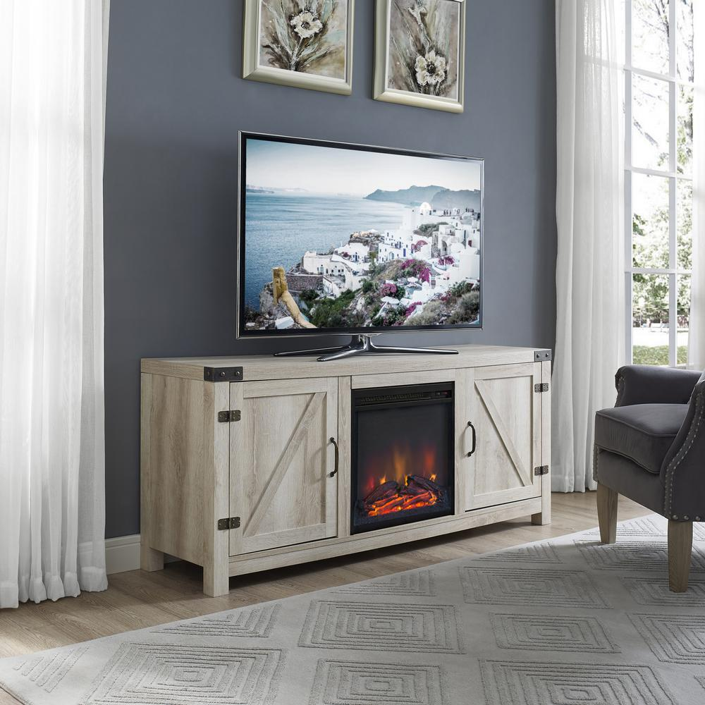 This cozy fireplace TV stand is the perfect piece to give your living or family room area a charming country feel. Features concealed storage space with side doors with adjustable shelving to fit your