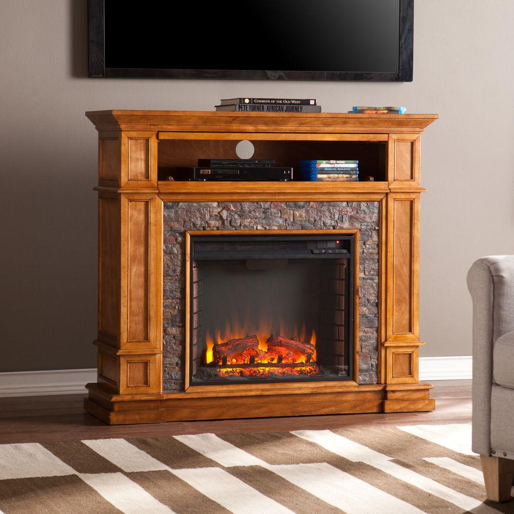 Warm up your living space with this Southern Enterprises Ethan Simulated Stone Media Center Electric Fireplace. Offers durability.