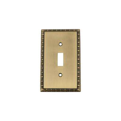 Egg and Dart Switch Plate with Single Toggle in Antique Brass