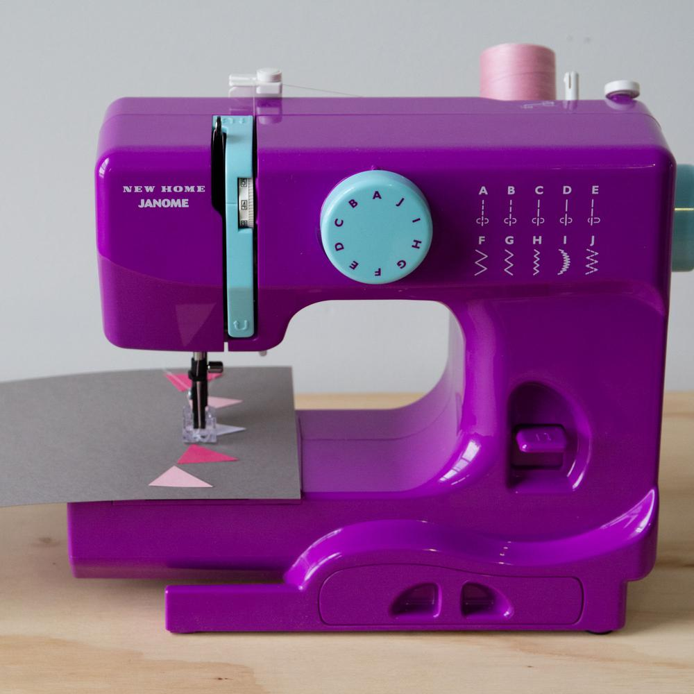 10-Stitch Sewing Machine, Purple This compact Janome sewing machine is a great choice for both the experienced sewist and the young enthusiast. This compact machine includes essential features for finishing many types of sewing projects, from simple tasks and mending to scrapbooking and paper crafting. At just 5 lbs. it's perfectly portable. It has ten stitch options and a left and center needle position. It features a tension control dial and a four-point feed dog system. Other colors available. Color: Purple.