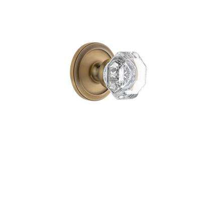 Circulaire Rosette 2-3/4 in. Backset Vintage Brass Passage Hall/Closet with Chambord Crystal Door Knob