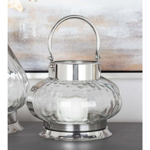 Litton Lane 12 in. Silver-Finished Stainless Steel Glass Pumpkin Candle Lantern