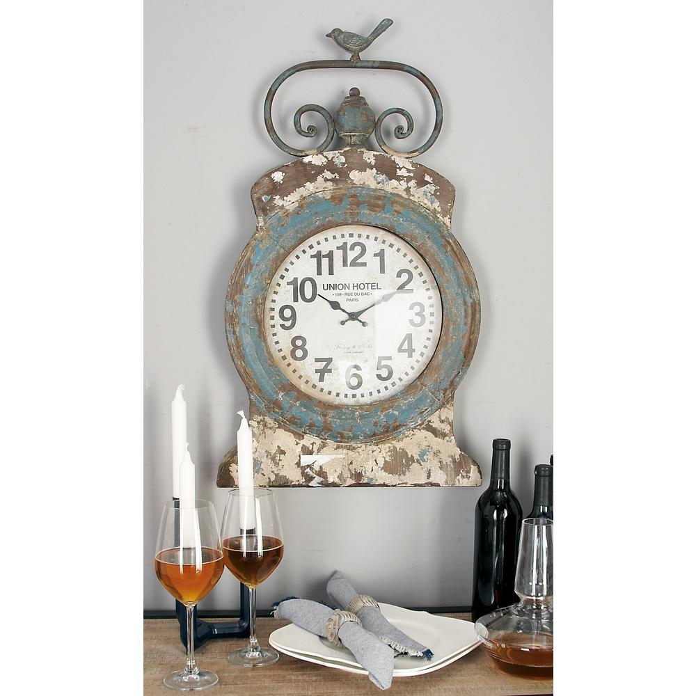 "LittonLane Litton Lane 30 in. x 17 in. Rustic Turquoise ""Union Hotel"" Table Clock with Scroll and Bird Finial"