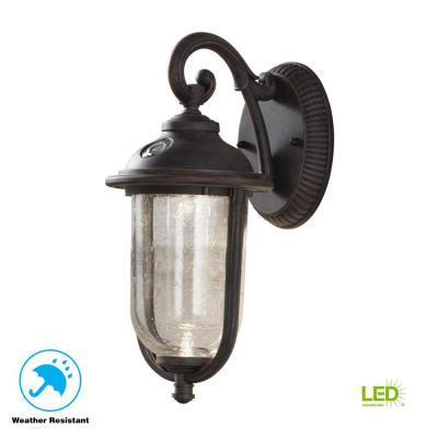 Perdido Rustic Bronze Outdoor Integrated LED 6 in. Wall Lantern Sconce with Photocell