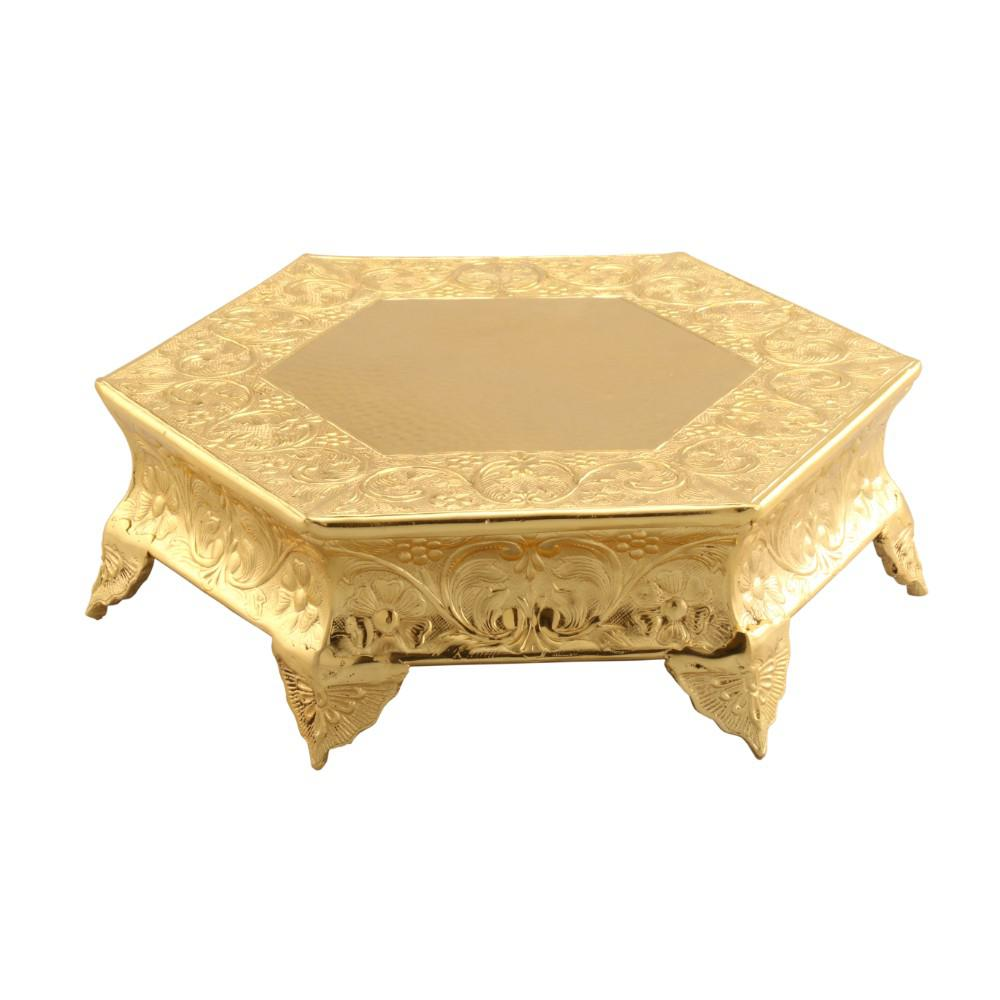 Hexagonal 16 in. Gold Metal Wedding Cake Stand This hexagonal wedding cake stand with beautifully en-carved corners makes it more prominent and a great inclusion to your kitchen and dining spaces. It is made of aluminum and features a shinny gold finish, giving this cake stand an imperial look. The unique style of this cake stand, compliments cakes of different shapes and sizes. You can even use this stand for showcasing wedding cake, birthday cake or for any theme party.