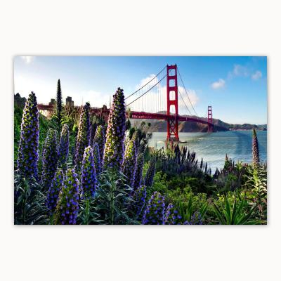 """""""Golden Gate With Flowers"""" by Christopher Knight Collection Canvas Wall Art 27 in. x 36 in."""