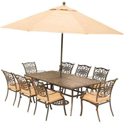Traditions 9-Piece Outdoor Dining Set with Rectangular Cast-Top Table with Natural Oat Cushions, Umbrella and Base