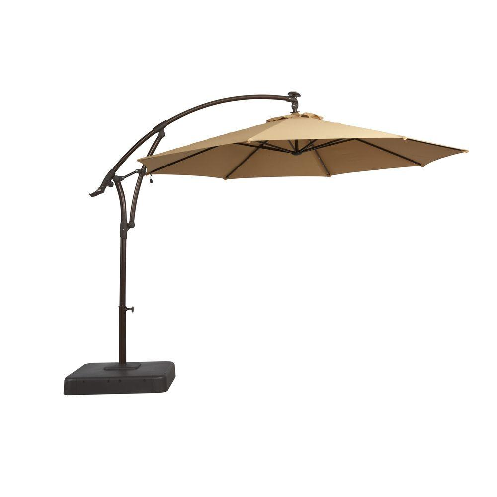 Hampton bay 11 ft offset led patio umbrella in tan for Balcony umbrella