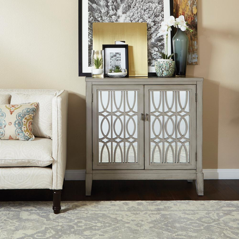 OSP Home Furnishings Vienna Console, Brown An elegant addition to any home, this mirrored storage cabinet combines the best of style and function. Relish the glam style of the geometric ornamental design with mirror inlay to reflect the beautiful surrounds of your home. Perfect for the front entry, living room, or bedroom craving a sophisticated storage solution. Find your chic style with the INSPIRED by Bassett Vienna console. Color: TAUPE.