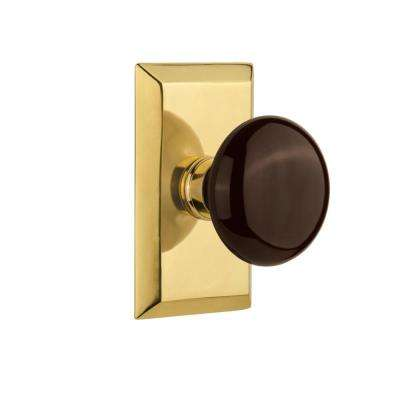 Studio Plate 2-3/8 in. Backset Polished Brass Privacy Bed/Bath Brown Porcelain Door Knob