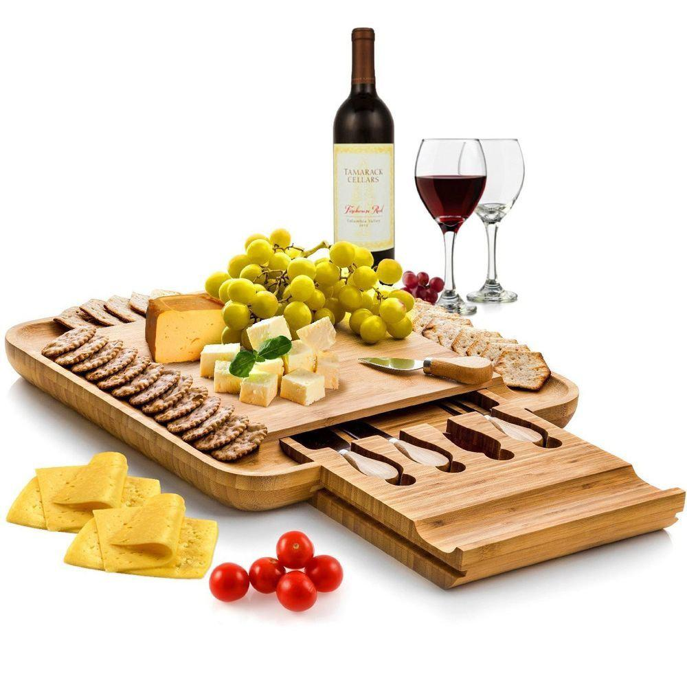 100% Natural Bamboo Cheese Board & Cutlery Set with Slide-Out Drawer, Light Brown Wood The all-in-one board for social entertainingFrom serving cheese to dried meats to crackers, The Bambsi Serving Platter adds that special touch for any social gathering that you host in your house.During the football or summer season, you will want to have friends and guests for wine and cheese every weekend while everyone shares fun stories about their lives, and this serving platter is designed with that in mind. Our serving platter warms up your guest appetites with fine Farmhouse Cheddar, Artisan Bread, or any alluring meal that you have prepared.Drawer slides smoothly to reveal the utilitarian utensilsThe Bambsi Cheese Board has a pull-out drawer that gives that chic quality display. In it, youll find four Stainless Steel cutlery set with wooden handles to slice, cut, and serve fruits, cheese, and bite sized appetizers so everyone can serve themselves. Also, youll find two chalk and slates to help your guest identify the different cheeses and snacks youll have over the serving platter.Beautiful, unique, attractive designPart of Bambsis exquisite line of products, we crafted this cheese board with premium Moso Bamboo, a kitchen-safe organic material that is harder than most other woods. It absorbs less liquid, and with its natural antibacterial properties, it requires little maintenance. Color: Light Brown Wood.