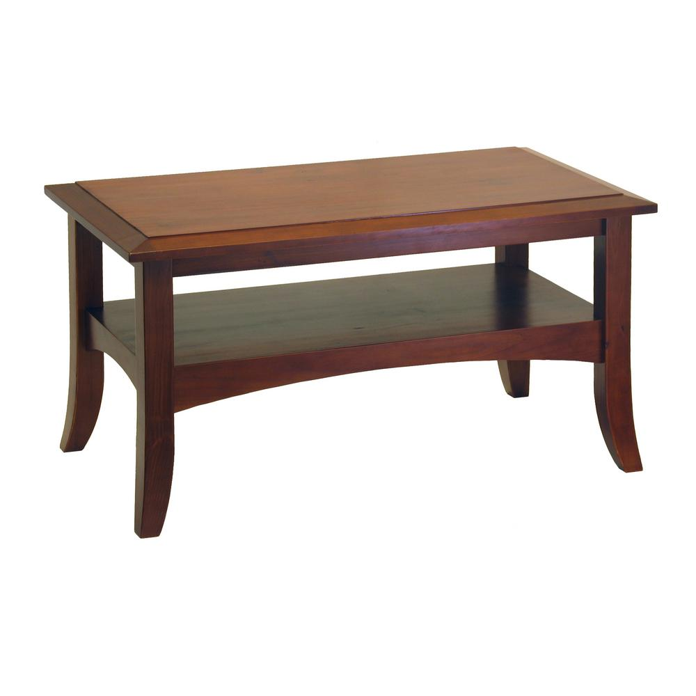 Winsome Wood Craftsman Walnut Coffee Table, Brown Place all your drinks, snacks, and TV accessories at arm's reach with the Winsome Wood Craftsman Coffee Table and enjoy a cozy evening at home. This coffee table has a classic style, which will elevate your living room with a timeless piece. It has a wooden design, conveying elegance and charm. Featuring storage space, this coffee table gives you a convenient spot to hold extra blankets or any other items you frequently use in your living room. Color: Walnut.