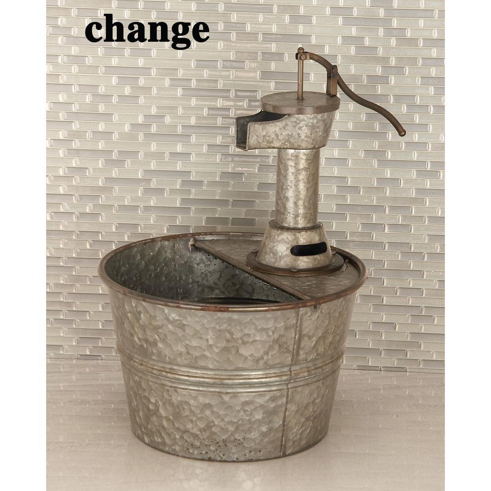 Gray Bucket Under Water Pump Metal Fountain