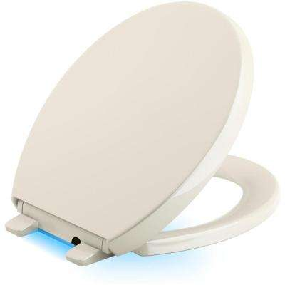 Reveal LED Nightlight Round Closed Front Toilet Seat in Biscuit
