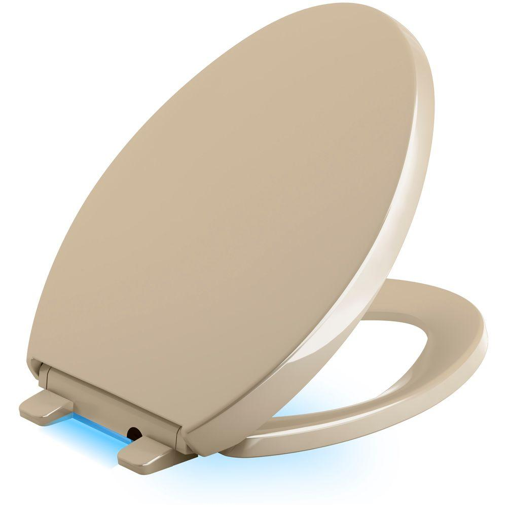 Reveal LED Nightlight Elongated Closed Front Toilet Seat in Mexican Sand
