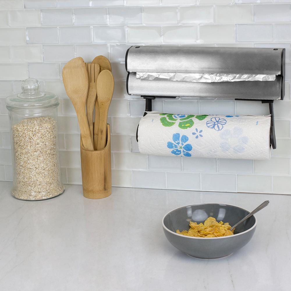 Home Basics Wall Mount Paper Towel Holder with Integrated Wrap Dispenser, Silver This all-in-one paper towel holder with integrated plastic wrap dispenser is perfect for keeping a neat and organized cooking space. With a stainless-steel construction, it is built to last and coordinate with existing kitchen decor. You'll never have to deal with cluttering up your countertops to display a paper towel roll or have to deal with rummaging through disastrous drawers to find your plastic wraps and foils. This handy kitchen must-have keeps it all in one centralized location and saves you space with its wall-mounted design. The foil dispenser Features precision serrated blades that evenly cut a single sheet of foil, saran wrap and more. The bottom rod accommodates a single paper towel roll, so you'll have easy to access to paper towels when you need to clean up every day messes. Color: Silver.