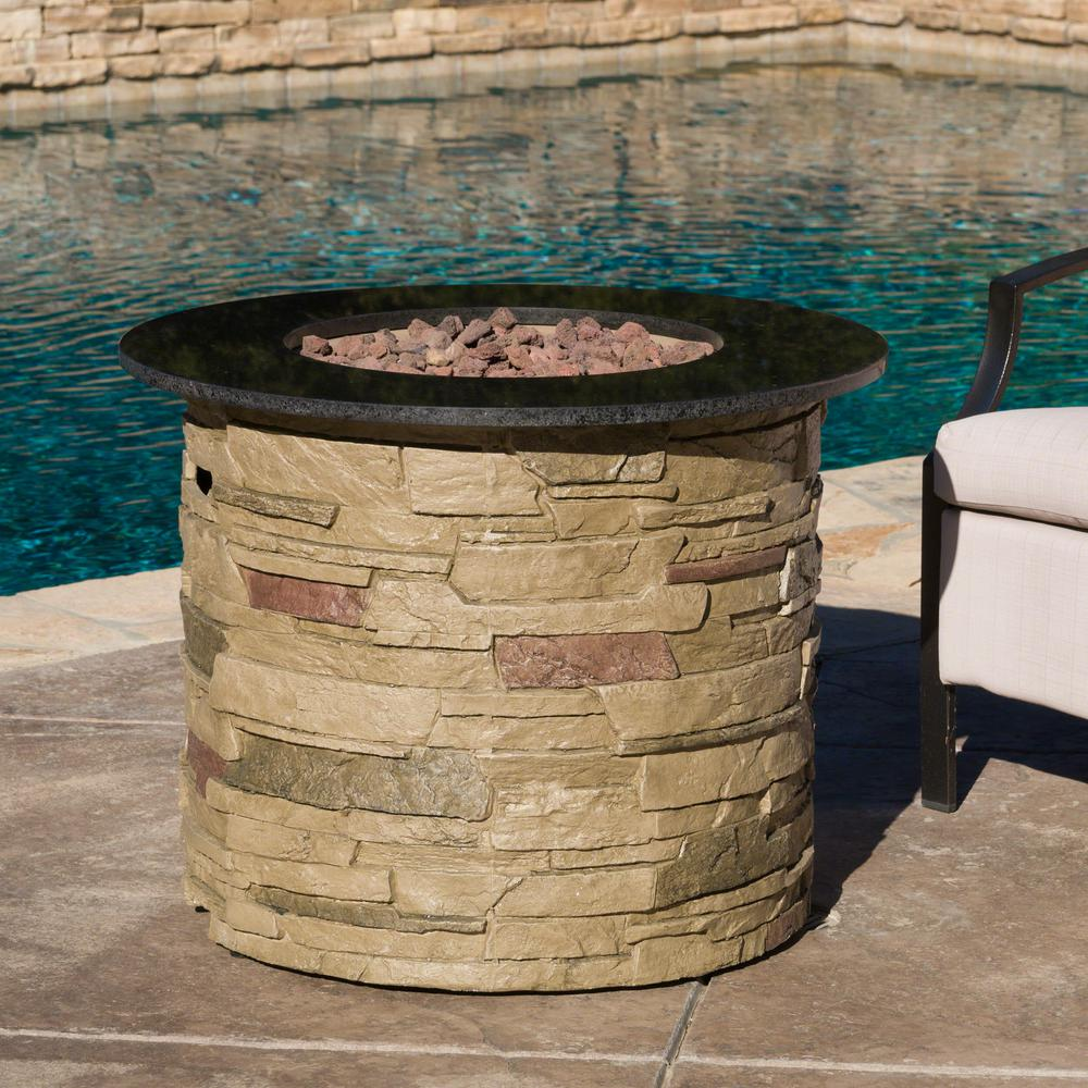 Noble House Hoonah 32 in. x 24.00 in. Round Stone Gas Fire Pit with Black Top - 40,000 BTU