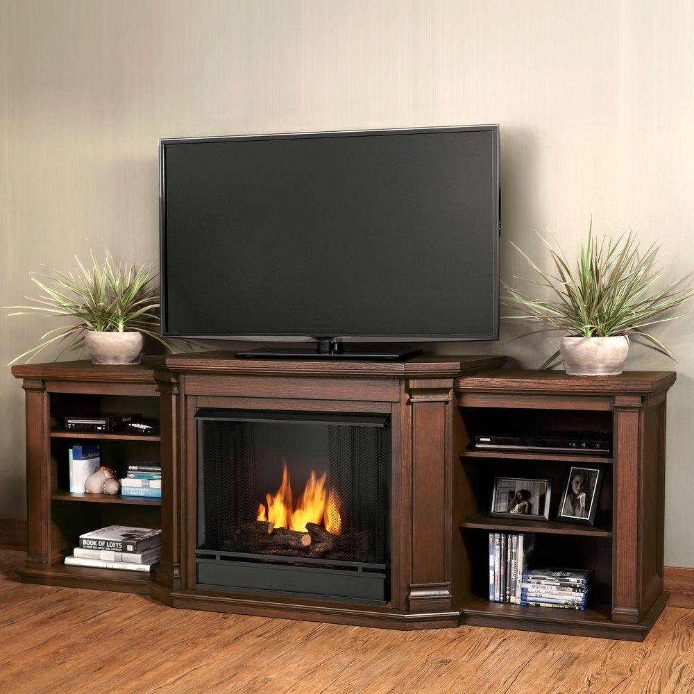 Angled columns with flared corbels and recessed side panels highlight the grand profile of the Valmont Mantel. Capable of safely supporting a television of 100 lbs. or less while adjustable shelving accommodates