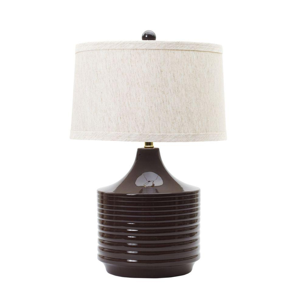 Fangio Lighting 24 in. Kohl Brown Ceramic Table Lamp Fangio Lighting's #8774 24 in. Ceramic Table Lamp will become an instant favorite with its warm Kohl Brown finish. Whether you are looking to infuse a splash of color into your room palette or desire a lamp that speaks for itself you are sure to be pleased with this light. Fangio Lighting loves to add a touch of subtle flare where it can and this lamp is no exception. The unique, mid-century inspired, contoured form will easily compliment your decor. With this lamp you don't have to sacrifice style for function as it comes complete with a fashion friendly, designer Beige Ribshan shade and an easy to use 3-Way switch. No matter if you lean towards decorating with a Traditional, Modern or Asian Infusion feel, this item will showcase your exceptional tastes. Show your American Pride. This lamp is UL approved and strives to add beauty to the world 1 lamp at a time. This light takes one 100-Watt bulb (not included).