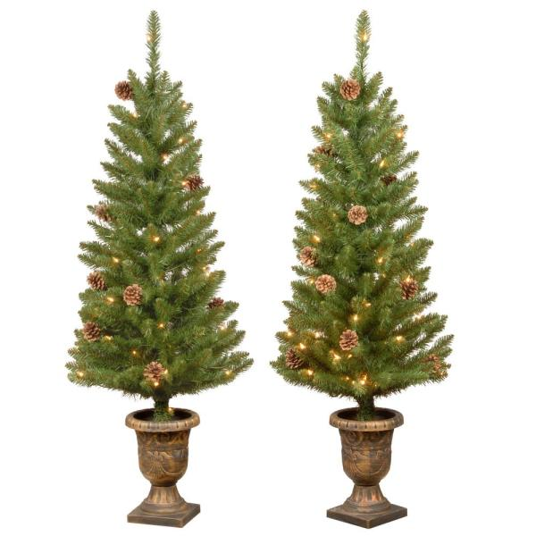 Home Accents Holiday 4 Ft Montclair Spruce Pre Lit Potted Artificial Christmas Trees With 70 White Mini Lights Set Of 2 Hmc7 310 40 2 The Home Depot