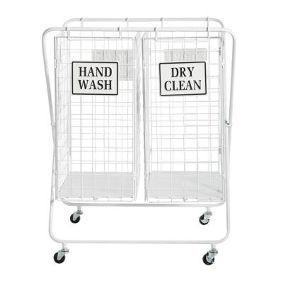 LITTON LANE Large White Metal Double Laundry Basket with Wheels and Decorative Signs, 23in x 31.5in