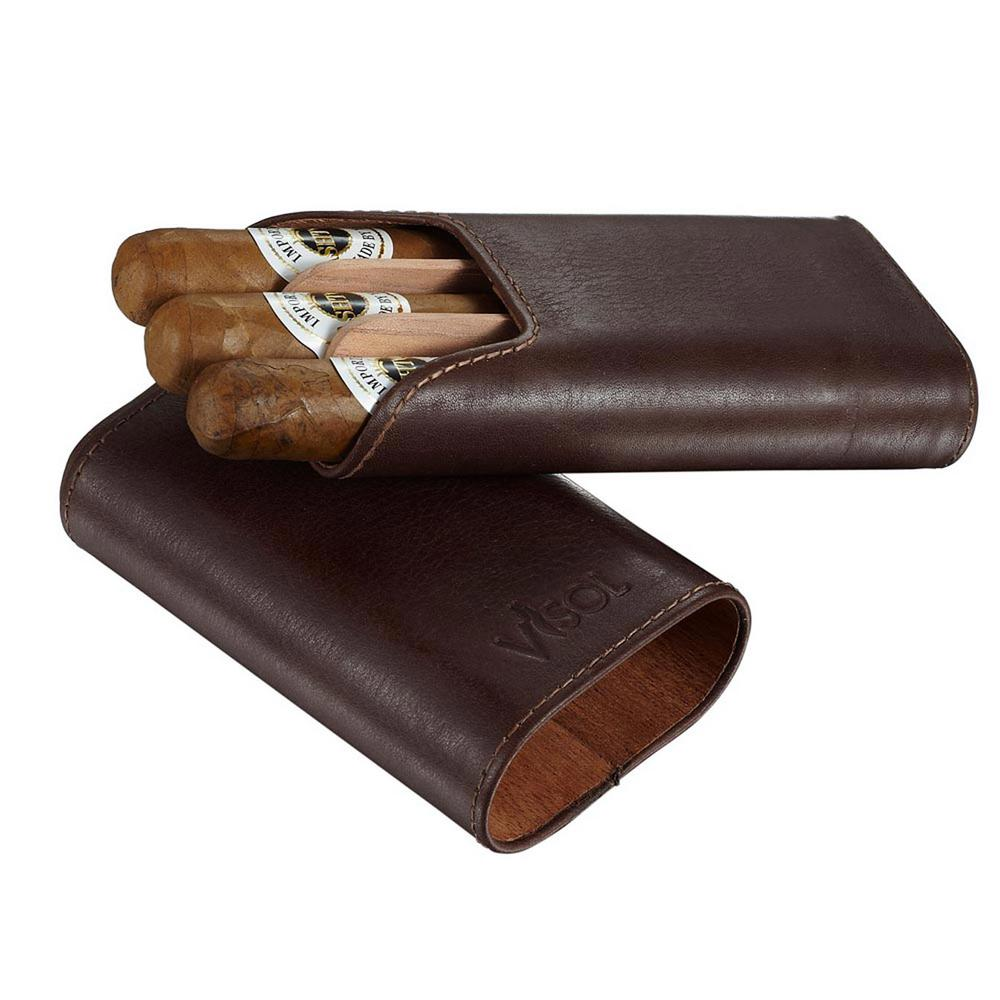 Visol Cuero Genuine Brown Leather 3 Cigar Case The Cuero by Visol is a beautifully crafted leather case that is sure to captivate any cigar enthusiast. The Cuero will hold 2 cigars up to a 62 ring gauge or 3 at a 54 ring gauge, and the cedar lining ensures that your cigars stay fresh longer. Don't worry about the safety of your precious cargo, this dark brown case protects the cigars with its extra rigid removable dividers. Add this handsome case to your cigar accessories by ordering today.