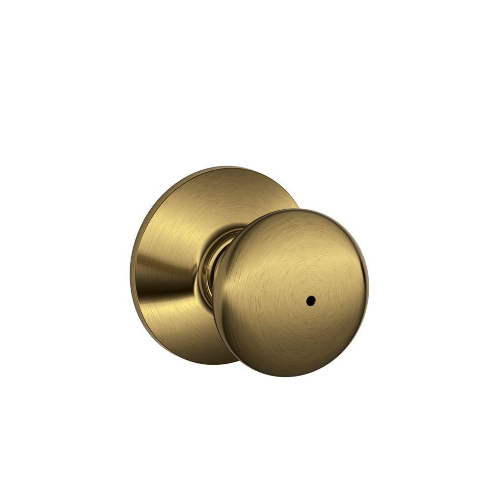 Schlage Plymouth Antique Brass Bed and Bath Knob
