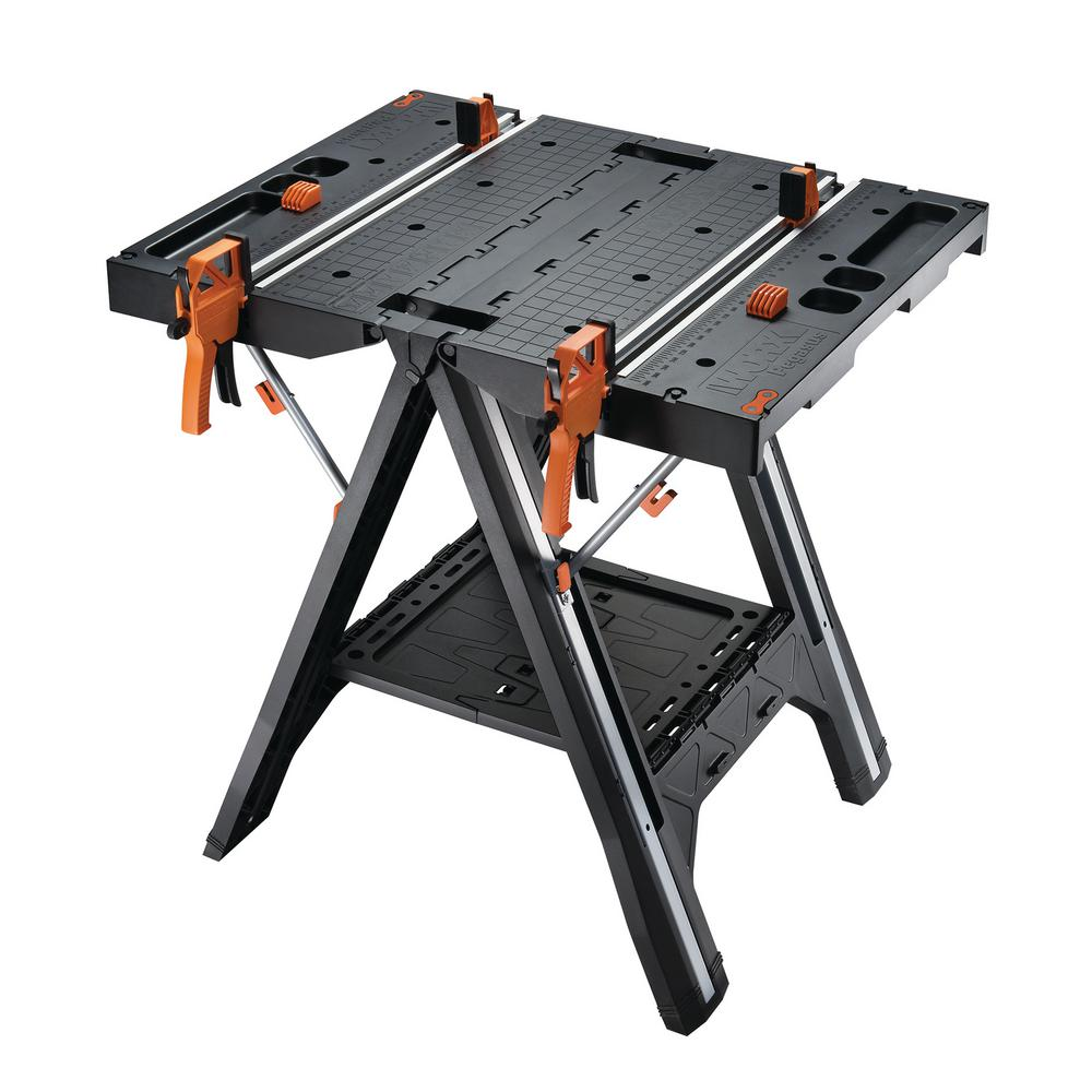 Worx Pegasus Multi Function Work Table And Sawhorse With Quick Clamps Holding Pegs