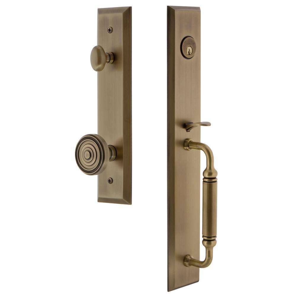 Fifth Avenue 2-3/4 in. Backset Vintage Brass 1-Piece Door Handleset with C-Grip and Soleil Knob