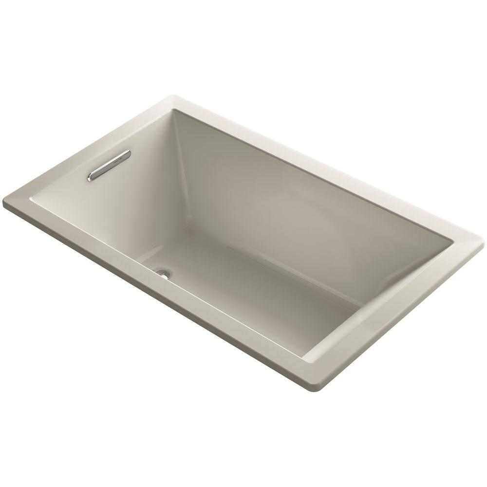 Kohler underscore 5 ft reversible drain rectangular for Deep soaking tub alcove