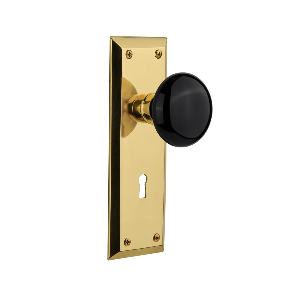 New York Plate Interior Mortise Black Porcelain Door Knob in Polished Brass