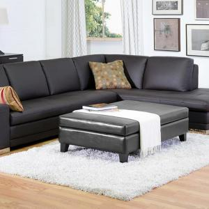Baxton Studio Jack Traditional Black Faux Leather Upholstered Storage Ottoman by