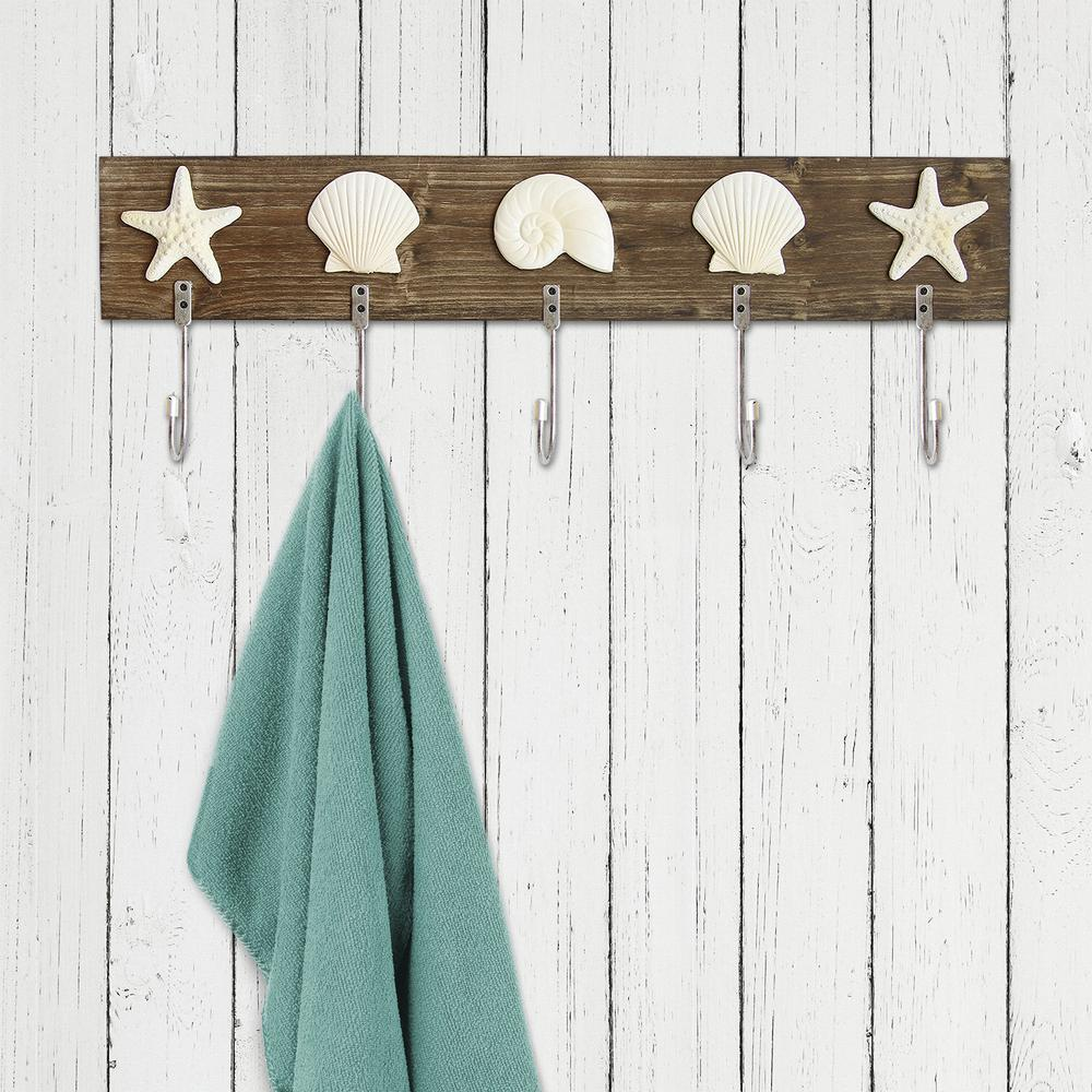 Stratton Home Decor Sea Shell Hooks Wall Decor, Brown Complete a room in your home with the Stratton Home decor Sea Shell Hooks Wall Decor. This charming accent piece is the perfect way to hang your coats and fill a space in any home. Display it in a nautical or coastal home for a cohesive feel. Color: Brown.