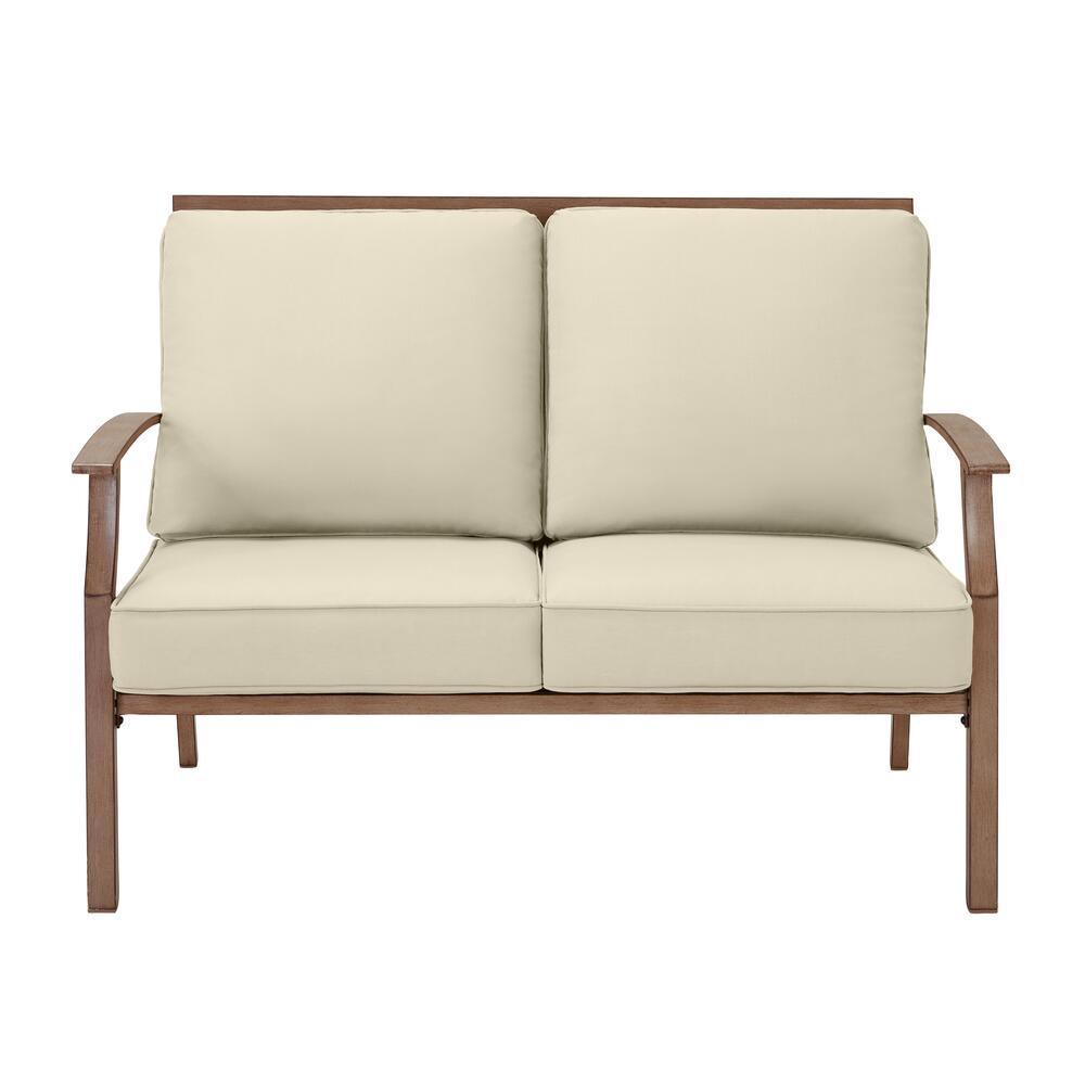 Geneva Brown Wicker Outdoor Patio Loveseat with CushionGuard Putty Tan Cushions
