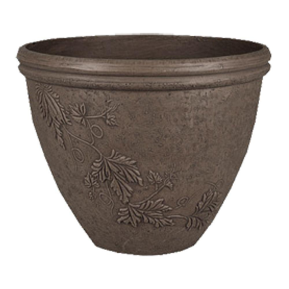 Arcadia Garden Products Vine 15 in. x 12 in. Dark Charcoal PSW Pot Give a nod to nature with this eye-catching design featuring a vine pattern in relief. A gently curved rim modernizes the classic silhouette. The PSW Pot Collection is named for its signature material blended from Plastic, Stone and Wood. Color: Dark Charcoal.