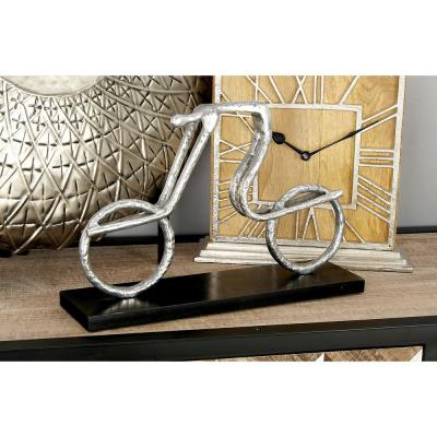 Litton Lane 9 in. Abstract Cyclist Decorative Sculpture in Textured Silver