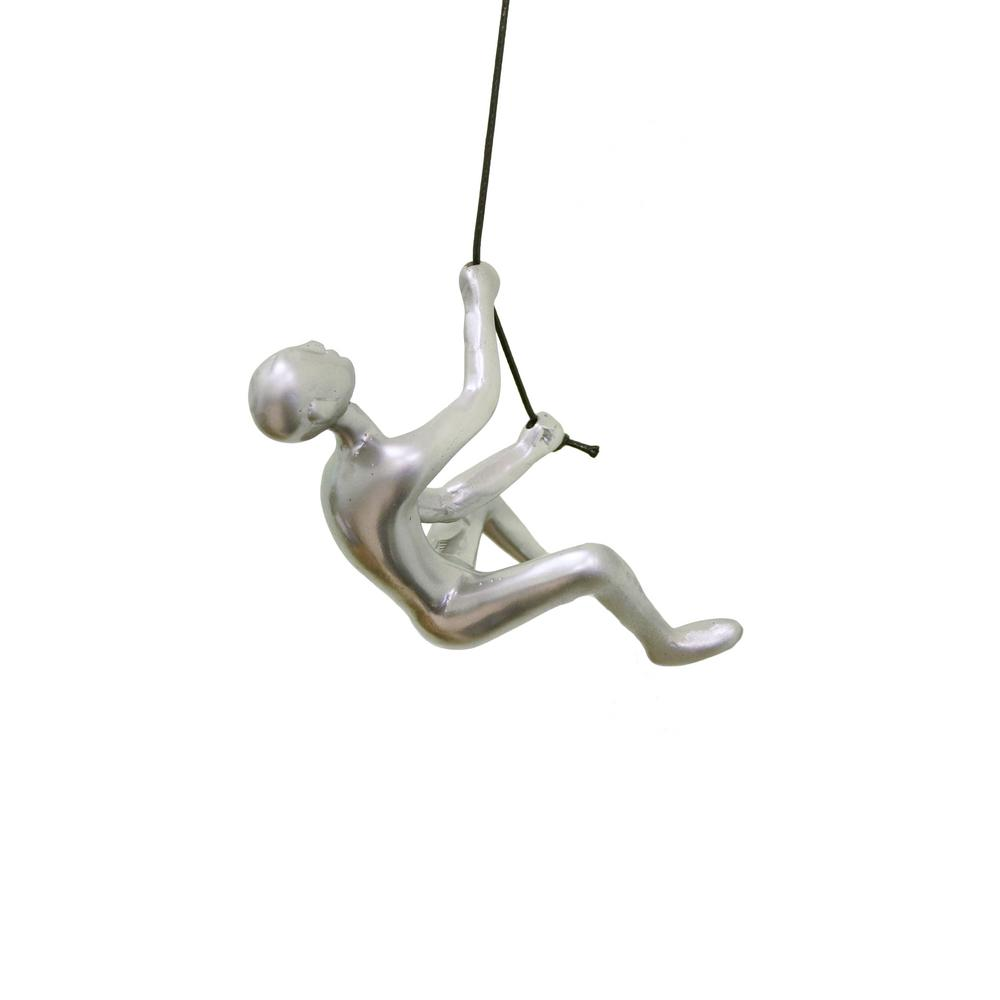 CLIMBING MAN WALL ART Climbing Man Silver Wall Art Elevate the originality of your decor with our unique Climbing Man Wall Art. This high-end wall sculpture creates the illusion of a man climbing on any surface from which he is hung - a striking 3-dimensional addition to your home or office wall. Made from durable resin, Climbing Man is an amazing conversation piece that looks great individually, as a staggered set or as a large grouping to make a bold design statement. Comes with a twisted loop-knot for easy installation, a 30 in. leather rope, hanging hardware and instructions. Color: SILVER.