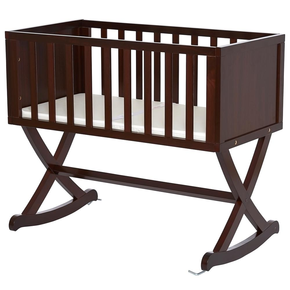 Dream On Me Haven Espresso (Brown) Cradle Dream On Me Haven cradle creates a cozy nest-like surrounding for your newborn. This cradle offers a simple and modern design by incorporating straight lines, a solid side panel with soft mattress pad and a x-cross base which allows parents to gently rock there babies to sleep. The Haven is essential to a chic loft nursery by just adding neutral tones combined with gold accents, sophisticated iron decors and pops of geometric prints which inspires a plush, peaceful, all-night comfort. Color: Espresso.