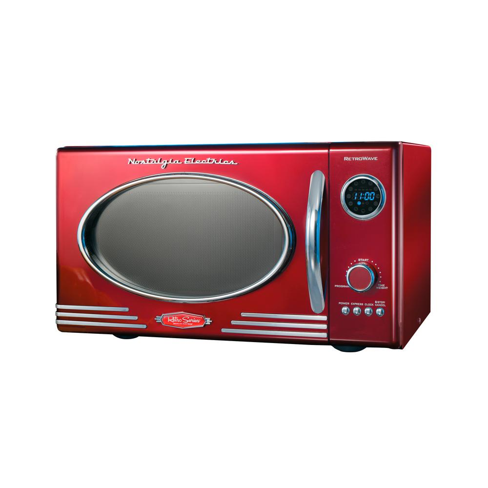 Nostalgia Retro 0.9 cu. Ft. Countertop Microwave Oven in Retro Red With a beautiful and sleek retro design, this microwave is sure to stand out in any kitchen. It features 12-pre programmed cooking settings and a bright LED display, making usability simple. Five power levels and 800-Watt of power are perfect for reheating leftovers or cooking food. Color: Retro Red.